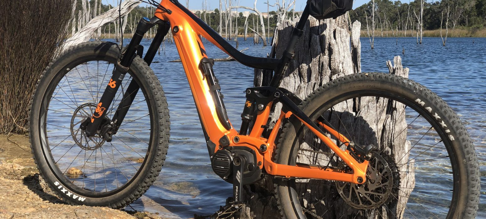 Giant Mountain E Bike eighth lake in back ground , rear tyre of bike is in the water.