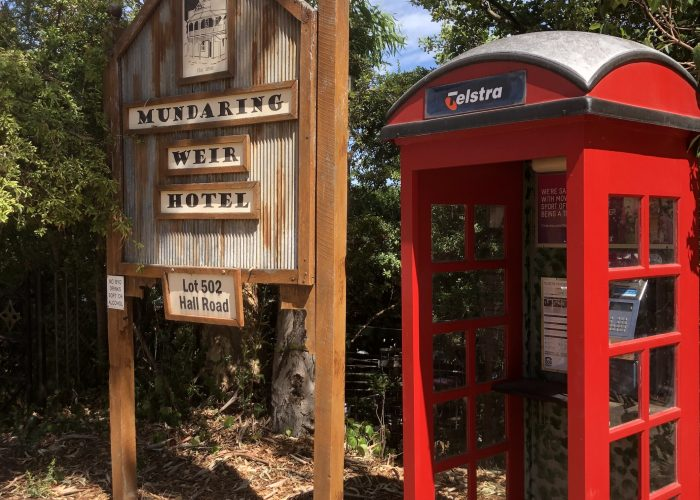 Old red phone box at the Mundaring Weir Hotel , another stop on a Perth Hills Mountain Bike Tour.